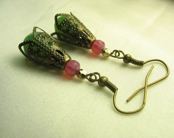 Green earrings ... green beads encased in antique brass bead caps with pink glass ... all wrapped up