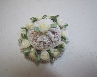 Hat for dollhouse doll in yellow flowers and lace.