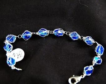 blue caged crystal bracelet