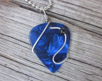Blue guitar pick with black onyx pendant