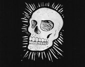 Skull hand pulled block print on archival textured black paper