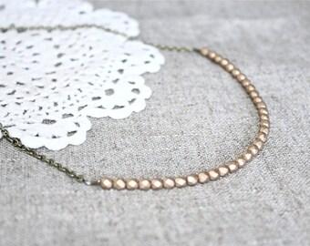 Matte gold beaded strand necklace.  Czech glass petite beads.