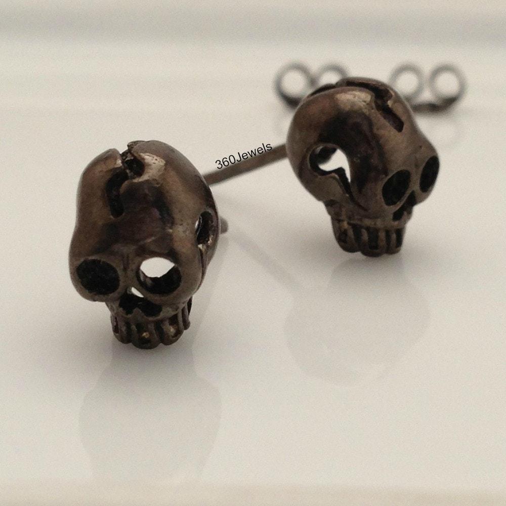 ossified black skull stud earrings s stud earrings