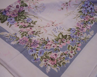 Vintage tablecloth in pinks and blues