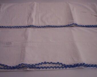 Crisp white vintage set of pillowcases blue trim
