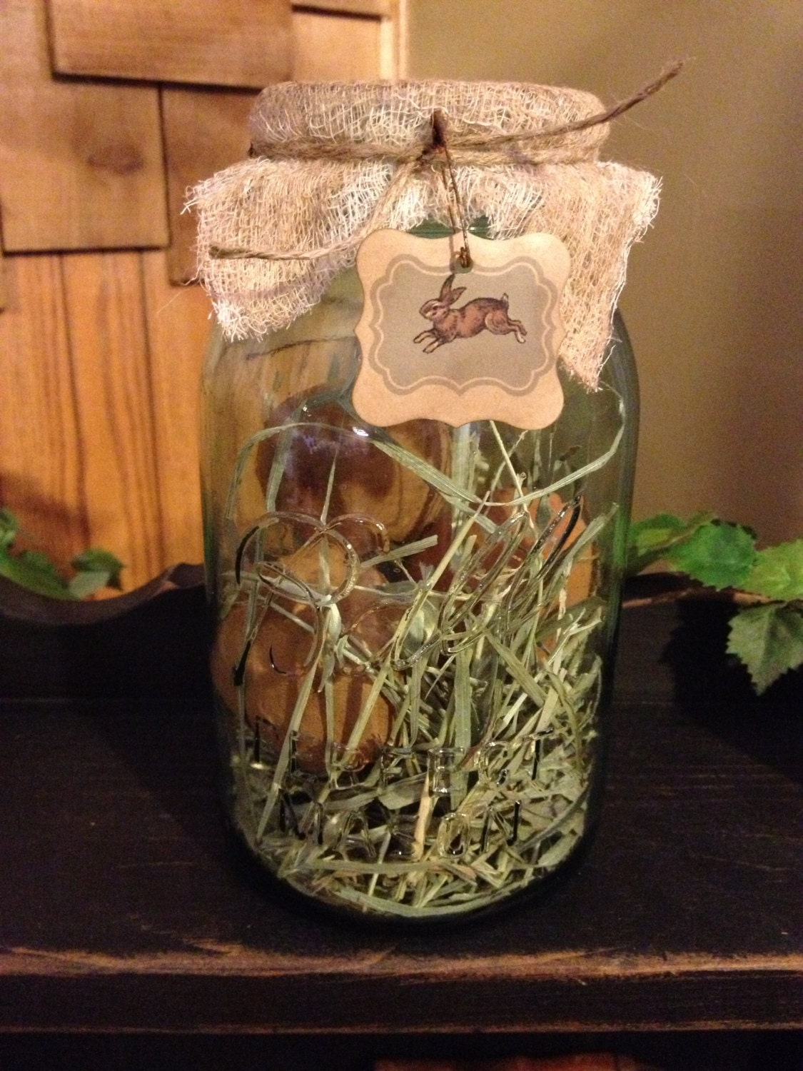 This blue Ball Mason Jar is filled with primitive wax-dipped eggs! Love it
