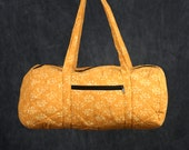 Quilted Duffle bag in Mustard Yellow with Cream Batik Print.