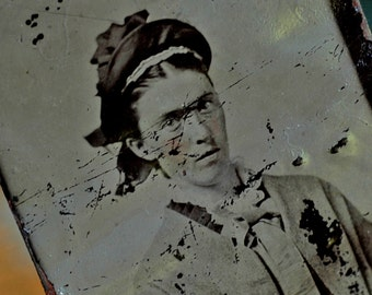aunt Tilly, God bless her cranky soul, came back to hunt them in dreams...  tintype photo... c. 1800...   L Bag 3
