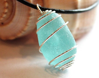 Eco Friendly Sea Glass wrap around with sterling silver plated wire cage on a real leather necklace.