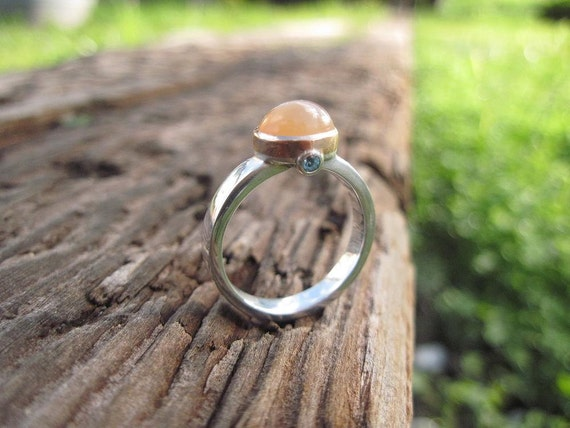 Orange Moonstone and Blue Topaz Ring in Sterling silver with Rose Gold Bezel