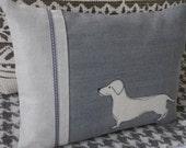 hand printed muted blue sausage dog cushion