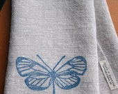 linen tea towel block printed with turquoise butterfly (mineral blue on oatmeal linen)