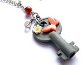 vintage key necklace, vintage butterfly, daisy with gemstones, swarovski crystals, unique ooak