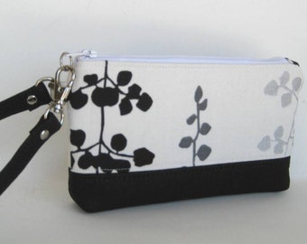 Wristlet in White with Black, Gray and Silver Blossoms and Leather Trim