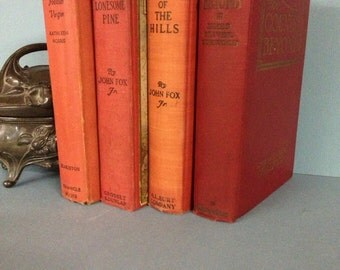 4 Old Books In Shades Of Red