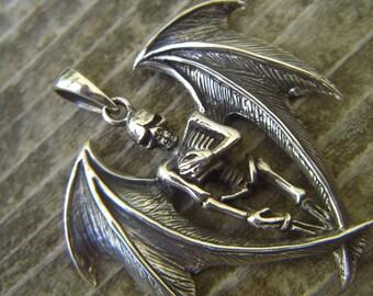 Winged skelton pendant in sterling silver