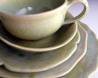 Five piece place settings, tea cup, small bowl, tea plate, side plate dinner/breakfast plate by Leslie Freeman