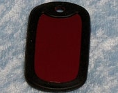 Tag Silencer.   Rubber surround for military style tags