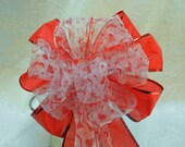 Valentine Bow sheer ribbon with red hearts and swirls on red ribbon