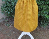 Handmade girl's mustard yellow with small flowers apron