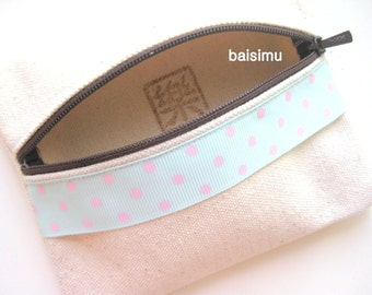 Multipurpose zipped purse with pastel polka dots ribbon, handprinted with Happiness