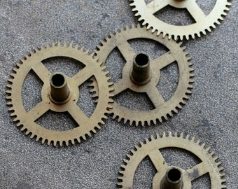Vintage clock brass gears -- set of 4 -- D9