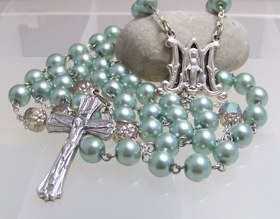 handmade Catholic rosary with pastel teal green glass pearls in silver