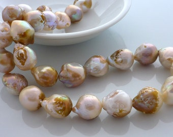 Stunning creamy nucleated flameball pearls 15-18mm