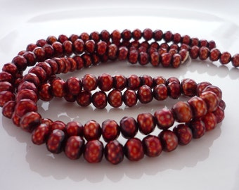 Cranberry faceted button pearls 6mm 1/2 strand