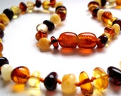 Baltic Amber  BABY  TEETHING  NECKLACE.  Multicolor  roundish  shape.