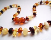 Multicolored  BALTIC  AMBER   TEETHING  Necklace for your Baby. Handmade knotted.