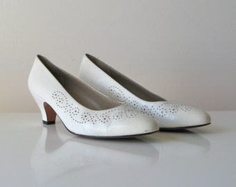 vintage Ferragamo perforated pumps