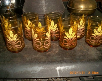 8 late 50's early 60's Amber  colored glass with Wheat stocks tied in ribbon baby tumbers