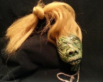 Green  shrunken head