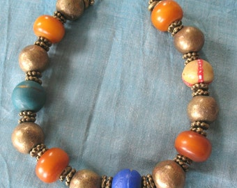 Price Reduced--African amber necklace with brass and trade beads