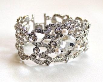 Bridal luxury swarovski rhinestone intricate jewel pearl bracelet.