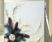 """Beautiful wedding guest book with feathers, roses and pearls in turquoise/chocolate/ivory, 11""""x 10"""" with a pen attached"""