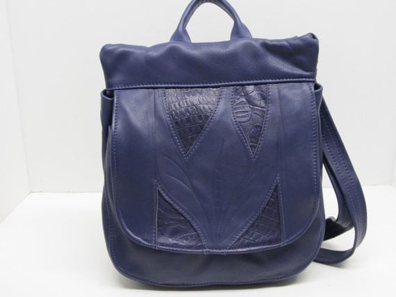 Purple leather backpack or messenger bag or purse shoulder