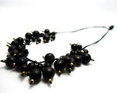large golden and black acai and coconut seed beadwoven necklace