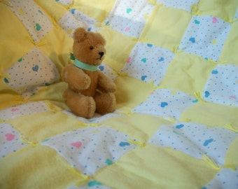 Yellow and white hand-tied baby quilt with hearts