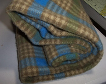 Plaid felted wool fabric in blue, green and tan.