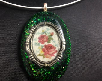 Rose Cameo in Resin on a Glittery Green Background