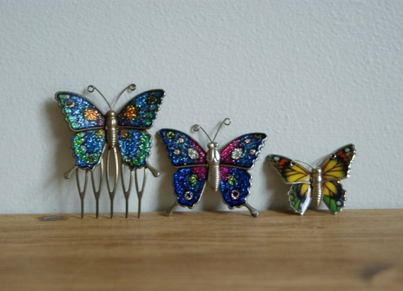 Glittery 1980s retro butterfly brooches and hair comb