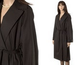 Black belted wrap coat by designer Diane Von Furstenberg DVF. Overcoat raincoat