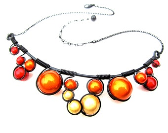 Yellow, Orange and Red Miracle Beads, Wrapped in Black Wire and adjustable black chain.