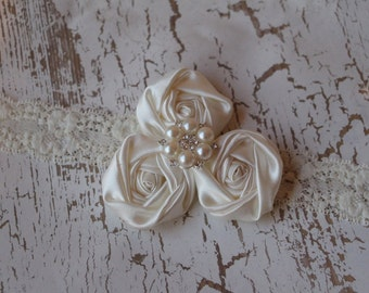 Ivory rosettes on lace elastic headband