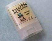 Carousel Scented lotion stick with grapefruit and wintergreen essential oils