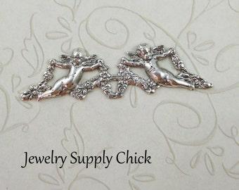 Silver Ox  Cherub ornamental stamping (x2)