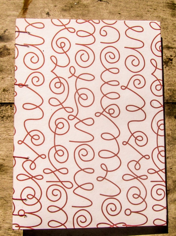 Handbound SCRIBBLE original design hardcover journal/sketchbook with recycled blank white pages and burgundy Coptic stitching.