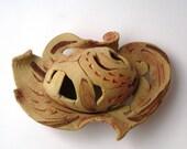 Ceramic egg in small ceramic nest